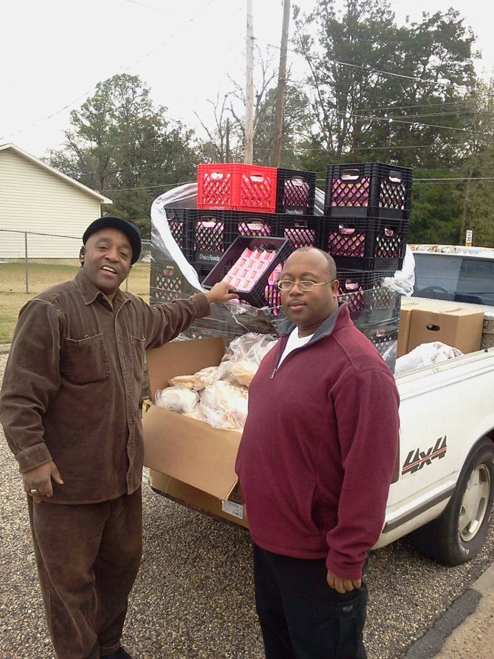 Earl Jones jr. And Pastor giving away milk and chicken