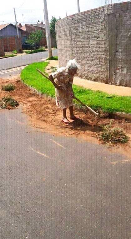 old lady cleaning outside of church